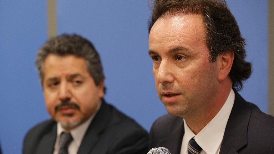 President of the Syrian National Coalition Khaled Khoja, right, is joined by Syrian National Coalition Special Representative to the U.S. and the United Nations Najib Ghadbian as he speaks to reporters during a news conference, Wednesday, Sept. 30, 2015 at U.N. headquarters. (AP Photo/Mary Altaffer)