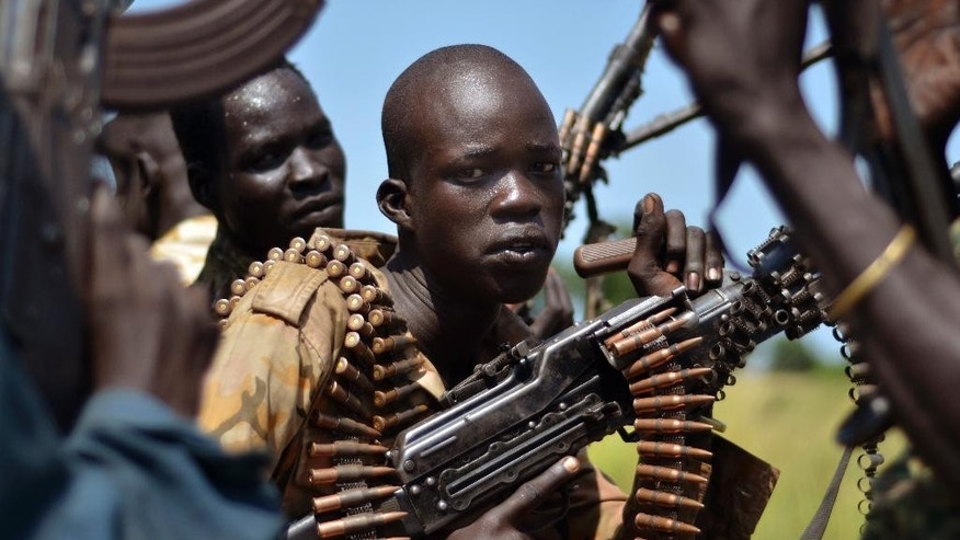 FILE-- In this file photo of Friday, Sept. 25, 2015. South Sudan government soldiers in the town of Koch, Unity state, South Sudan.   Fifty-two soldiers and rebels have been killed in recent fighting in South Sudan's contested state of Unity, a military official Saturday, blaming rebels for the latest violation of a peace deal signed last month amid high hopes for peace. ((AP Photo/Jason Patinkin-file)
