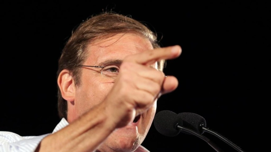 Portuguese Prime Minister Pedro Passos Coelho gestures while delivering a speech during his government coalition  election campaign closing rally in Lisbon, Portugal, Friday, Oct. 2, 2015. Portugal goes to the polls to elect a new government on Sunday. (AP Photo/Armando Franca)