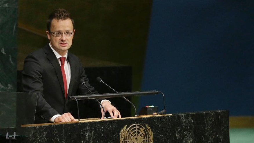 Hungary's Foreign Minister Peter Szijjarto addresses the 70th session of the United Nations General Assembly, Saturday, Oct. 3, 2015 at U.N. Headquarters. (AP Photo/Mary Altaffer)