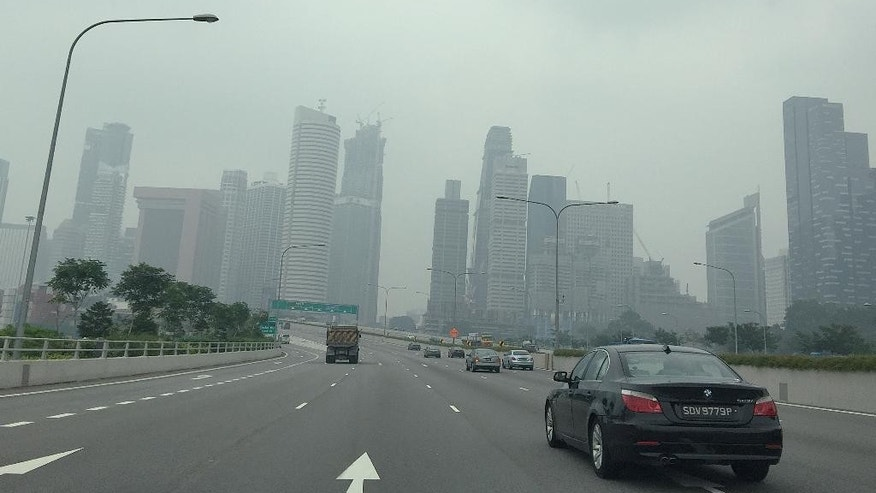 The financial skyline is seen through a thick haze, Saturday, Oct. 3, 2015, in Singapore. The haze is caused by the burning of forests in Indonesia's Sumatra and Borneo islands.  (AP Photo/Wong Maye-E)