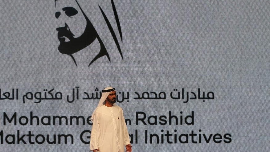 Sheikh Mohammed bin Rashid Al Maktoum, UAE prime minister and the ruler of Dubai announces the launch of the Mohammed bin Rashid Al Maktoum Global Initiatives project in a ballroom at the Emirates Towers, in Dubai, United Arab Emirates. Sunday, October 4, 2015. The ruler of Dubai is launching the new foundation to consolidate a range of charitable and human development initiatives that aims to support more than $270 million in projects annually. The project hopes to reach more than 130 million people in at least 116 countries in the coming years, though much of its work will target the Arab world. (AP Photo/Kamran Jebreili)