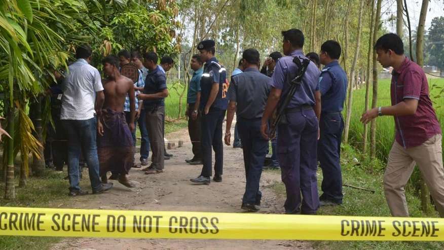 Oct. 3, 2015: Bangladeshi security officers stand by the site where a Japanese Kunio Hoshi was killed at Mahiganj village in Rangpur district, 300 kilometers (185 miles) north of Dhaka, Bangladesh.