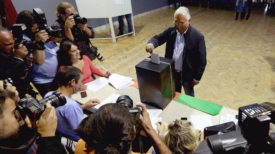 Socialist Party leader, Antonio Costa, casts his ballot in Portugal's general elections Sunday, Oct. 4, 2015, in Fontanelas, Sintra, outside Lisbon. The last polls ahead of Sunday's election showed the center-right ruling coalition roughly level  with the center-left Socialist Party, the main opposition. (AP Photo/Steven Governo)