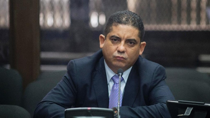 """Juan Carlos Monzon Rojas, the personal secretary of former Vice President Roxana Baldetti, appears before a court after he turned himself in to authorities in Guatemala City, Monday, Oct. 5, 2015. Monzon is accused by authorities of being the head of a corruption ring, known as """"La Linea,"""" in which businesses allegedly paid kickbacks to government officials in exchange for lower import duties, which is believed to have bilked the government of millions of dollars. The corruption scandal has rocked the Guatemalan government and so far has caused the resignation of former President Otto Perez Molina and Baldetti, both jailed and facing charges for allegedly receiving the illegal payments. (AP Photo/Luis Soto)"""