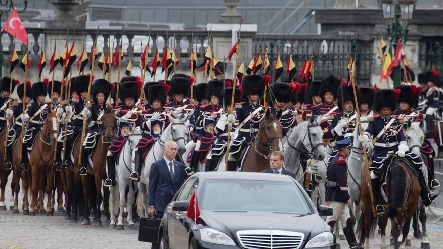 Mounted soldiers follow the car of Turkish President Recep Tayyip Erdogan as he arrives at the Royal Palace in Brussels on Monday, Oct. 5, 2015. Erdogan is on a two-day visit to meet Belgian and EU officials. (AP Photo/Virginia Mayo)