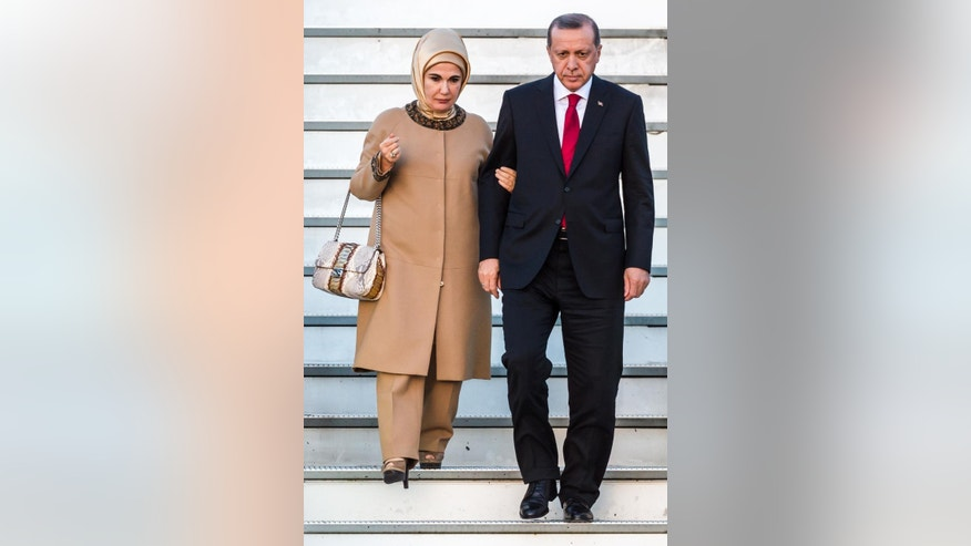Turkey's President Recep Tayyip Erdogan, right, and his wife Emine Erdogan arrive at Melsbroek military airport in Brussels on Sunday, Oct. 4, 2015. Erdogan is on a 3-day state visit to Belgium. (AP Photo/Geert Vanden Wijngaert)