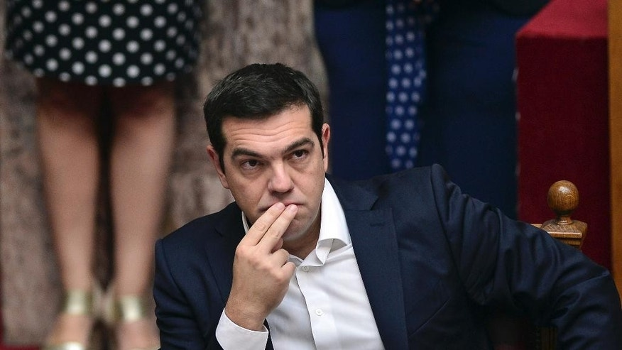 Greece's Prime minister Alexis Tsipras attends a swearing-in ceremony at the Greek parliament in Athens, Oct. 3, 2015.  This is the first parliamentary session where the 300 newly appointed lawmakers attend the ceremony after the Sept. 20 general elections. (Louisa Gouliamaki/Pool photo via AP)