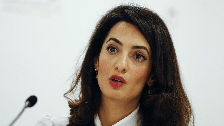 Amal Clooney of Doughty Street Chambers, legal counsel to Mohamed Nasheed, speaks during a press conference in London, Monday, Oct. 5, 2015. The press conference was held following the UN Working Group on Arbitrary Detention unanimously finding the detention of former Maldivian President Mohamed Nasheed in violation of international law. (AP Photo/Kirsty Wigglesworth)