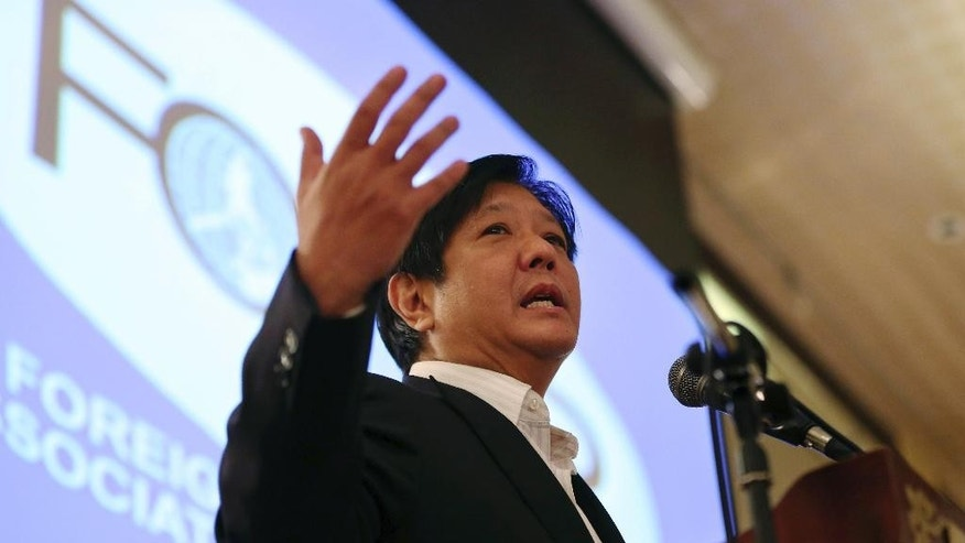 "FILE - In this Feb. 11, 2015 file photo, Sen. Ferdinand ""Bongbong"" Marcos Jr. gestures during his speech as he talks about the Bangsamoro Basic Law during the Foreign Correspondents Association of the Philippines meeting in Manila, Philippines. The son of late Philippine dictator Ferdinand Marcos has announced that he will run for vice president in next year's elections in a new gauge of his family's political clout nearly three decades after they were ousted in a ""people power"" revolt. Marcos asked Filipinos in a statement Monday, Oct. 5, 2015 to judge him based on his 26-year career in government as a provincial official and national lawmaker. (AP Photo/Aaron Favila, File)"