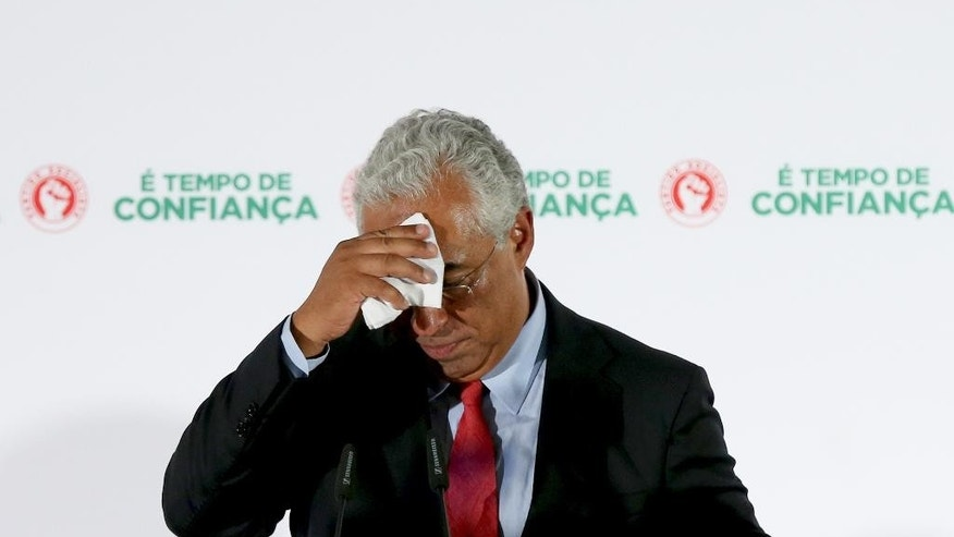 Portuguese Socialist leader Antonio Costa addresses supporters following the announcement of the results of Portugal's general elections Sunday, Oct. 4 2015, in Lisbon, Portugal. Polls showed the center-right ruling coalition winning over the center-left Socialist Party, the main opposition on Sunday. (AP Photo/Steven Governo)