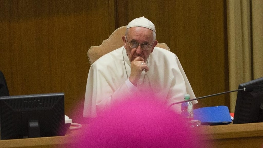 Pope Francis attends the opening session of a two-week bishops' meeting on family issues, at the Vatican, Monday, Oct. 5, 2015. The Synod of bishops and cardinals from around the world is aimed at making the church's teaching on family life relevant to today's Catholic families. (AP Photo/Alessandra Tarantino)