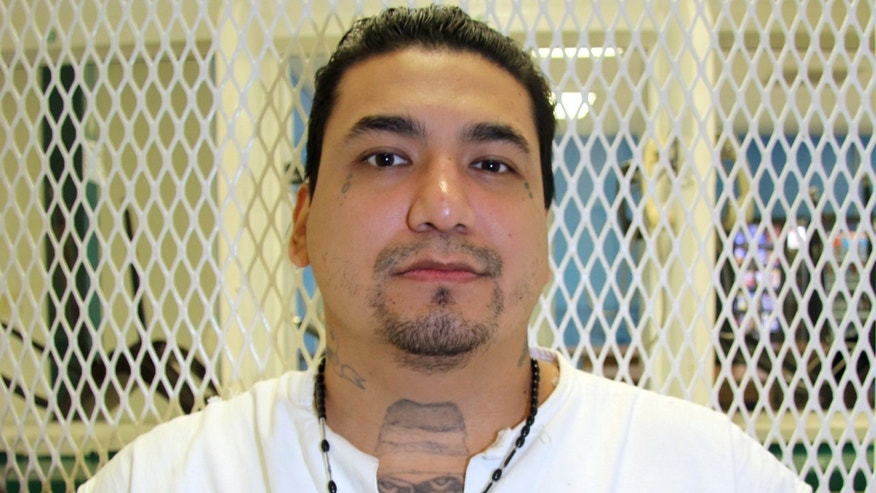 Death row inmate Juan Garcia is photographed in a visiting cage Wednesday, Sept. 2, 2015, at the Texas Department of Criminal Justice Polunsky Unit near Livingston, Texas. Garcia, 35, from Houston, is facing execution Oct. 6, 2015, for the 1998 robbery and fatal shooting of Hugo Solano, 36.  Evidence showed Garcia and three companions stole $8 from the victim. (AP Photo/Mike Graczyk)