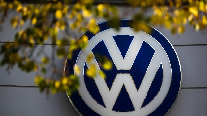 The VW sign of Germany's car company Volkswagen is displayed at the building of a company's retailer in, Berlin, Germany, Monday, Oct. 5, 2015. (AP Photo/Markus Schreiber)