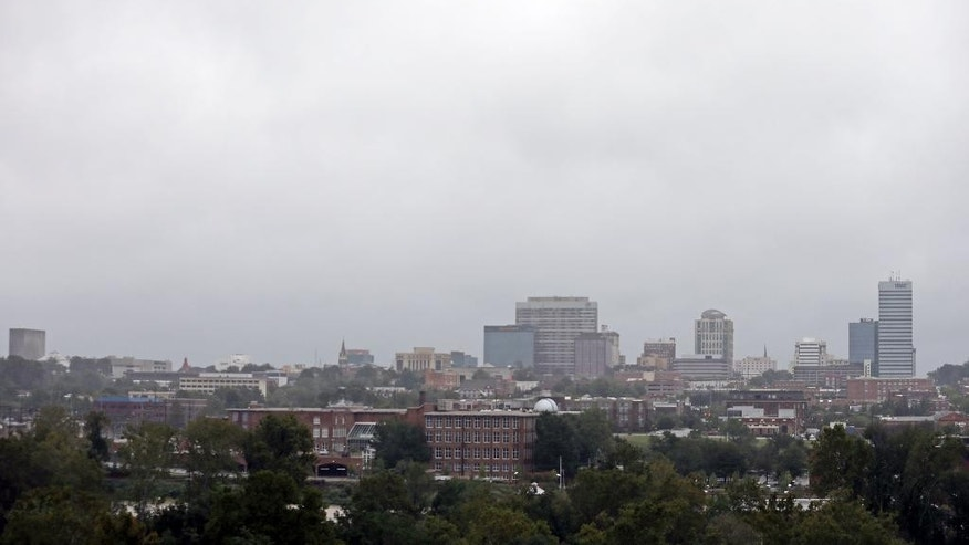 A helicopter flies over the Congaree River past the skyline of Columbia, S.C., Sunday, Oct. 4, 2015. Hundreds were rescued from fast-moving floodwaters Sunday in South Carolina as days of driving rain hit a dangerous crescendo that buckled buildings and roads, closed a major East Coast interstate route and threatened the drinking water supply for the capital city. (AP Photo/Chuck Burton)