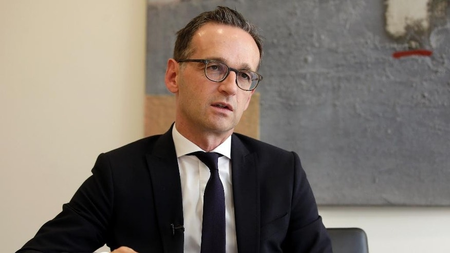 In this Oct. 5, 2015 photo German Minister of Justice, Heiko Maas, speaks during an interview with the news agency 'The Associated Press' at the ministry in Berlin, Germany. (AP Photo/Michael Sohn)