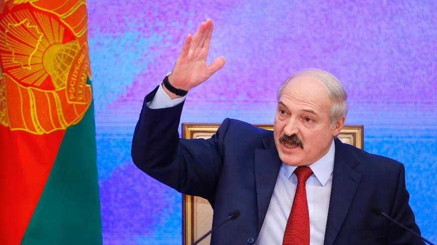 FILE - In this Thursday, Jan. 29, 2015 file photo, Belarusian President Alexander Lukashenko speaks during a news conference in Minsk, Belarus. Lukashenko said Tuesday that Belarus has no intention to host a Russian military base that Moscow wants to set up in the ex-Soviet nation. (AP Photo/Sergei Grits, file)