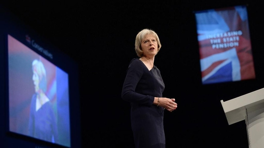 Britain's Home Secretary Theresa May delivers her speech at the Conservative Party conference at Manchester Central, England, Tuesday Oct. 6, 2015. Theresa May told the audience that Britain should tighten control of its borders, admitting vulnerable refugees but keeping out many people who simply want a better life. (Stefan Rousseau/PA via AP) UNITED KINGDOM OUT  NO SALES  NO ARCHIVE