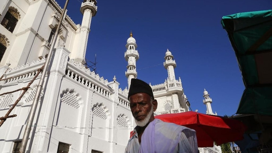 An Indian Muslim walks near the Jamia Masjid or the Grand Mosque surrounded by city's crowded shopping district in Bangalore, India, Tuesday, Oct. 6, 2015. The chief cleric of Bangalore's main mosque said Tuesday that he has advised the heads of hundreds of mosques in India's technology hub to actively counter propaganda by extremist Islamic groups by reaching out to young people in colleges and on social media. (AP Photo/Aijaz Rahi)