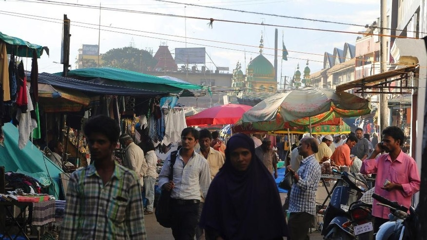 Indian shoppers crowd outside the Jamia Masjid or the Grand Mosque in Bangalore, India, Tuesday, Oct. 6, 2015. The chief cleric of Bangalore's main mosque said Tuesday that he has advised the heads of hundreds of mosques in India's technology hub to actively counter propaganda by extremist Islamic groups by reaching out to young people in colleges and on social media. (AP Photo/Aijaz Rahi)