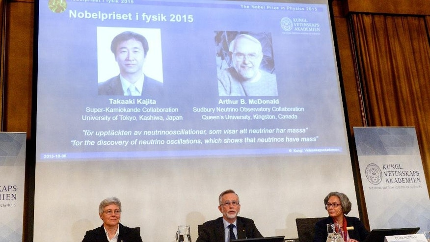 Professors Anne L'Huillier, left, Goran K. Hansson and Olga Botner, right, members of the Nobel Assembly announce the winner of the 2015 Nobel Prize in physics, in Stockholm, Tuesday Oct. 6, 2015. Takaaki Kajita of Japan and Arthur McDonald of Canada won the Nobel Prize in physics for the discovery of neutrino oscillations. The Royal Swedish Academy of Sciences said the two researchers had made key contributions to experiments showing that neutrinos change identities. (Fredrik Sandberg/TT via AP) SWEDEN OUT