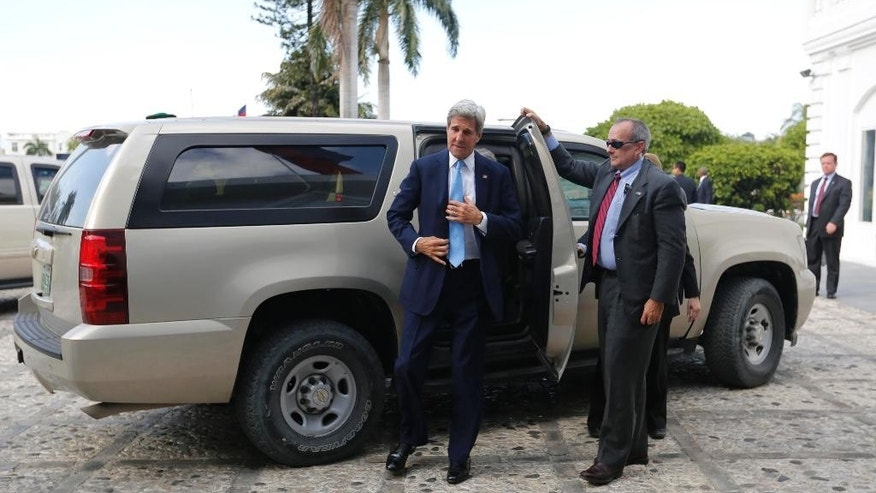 U.S. Secretary of State John Kerry arrives to the National Palace in Port-au-Prince, Haiti, Tuesday, Oct. 6, 2015. Kerry stopped briefly in Haiti to discuss preparations for the country's presidential and parliamentary elections on Oct. 25. (AP Photo/Dieu Nalio Chery)