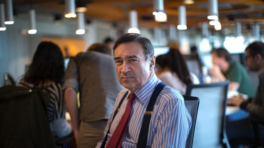 In this Friday, Oct. 2, 2015 photo, Pedro J. Ramirez, director of new digital publication 'El Espanol', poses for a photo at the editorial department of the new digital news site. The legendary Spanish newspaper editor is flush with 18 million euros ($20 million) from crowdfunding, well-heeled investors and the payoff he received for leaving Spain's No. 2 newspaper. With that haul, Ramirez is about to launch a startup digital publication aimed at shaking up Spanish journalism and scooping traditional and new media competition. (AP Photo/Emilio Morenatti)