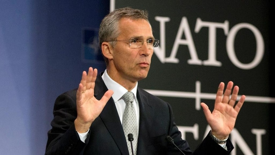 NATO Secretary General Jens Stoltenberg speaks during a media conference at NATO headquarters in Brussels on Tuesday, Oct. 6, 2015. NATO defense ministers will meet on Thursday, Oct. 8, 2015 to discuss, among other issues, the situation after a Russian fighter jet entered Turkish airspace from Syria over the weekend. (AP Photo/Virginia Mayo)