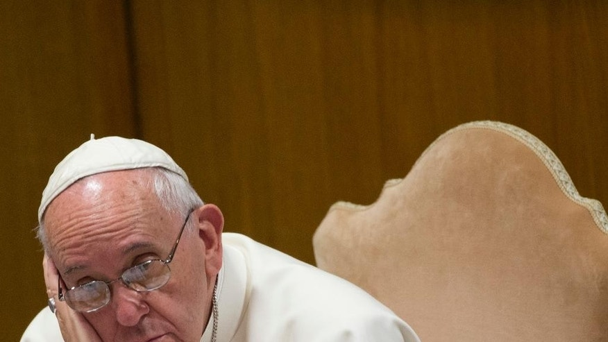 Pope Francis listens to the opening speech during a morning session of the Synod of bishops, at the Vatican, Tuesday, Oct. 6, 2015. (AP Photo/Alessandra Tarantino)