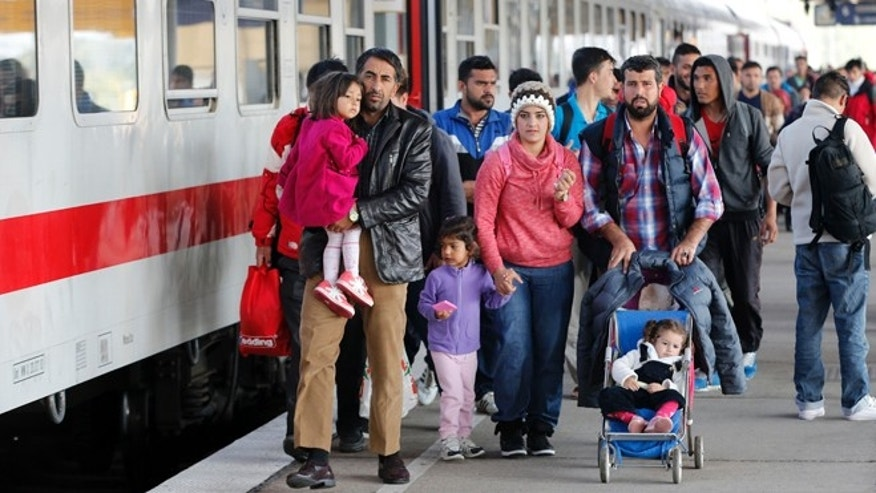 Oct. 5, 2015: Refugees from Syria walk along a platform after arriving from Salzburg, Austria, at Schoenefeld railway station in Berlin, Germany.