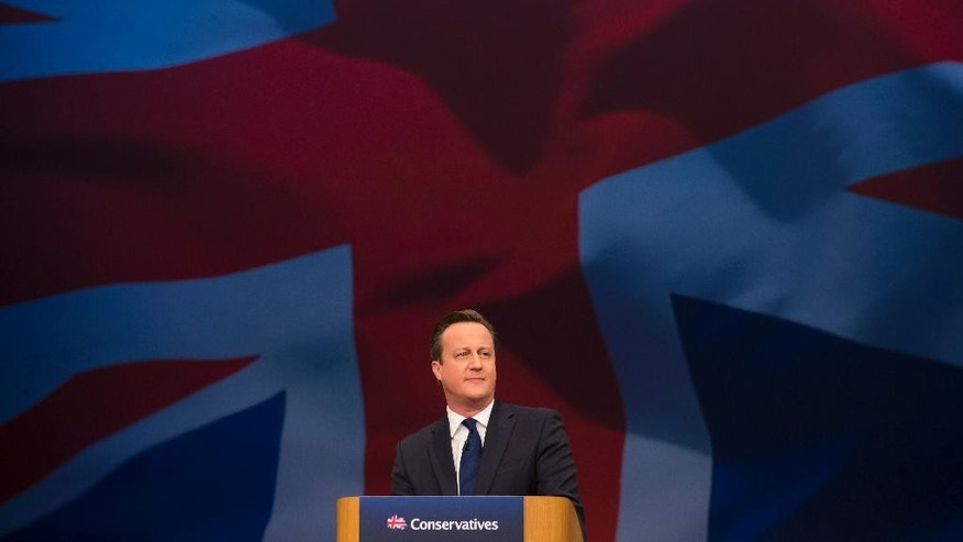 Britain's Prime Minister David Cameron makes his keynote speech at the annual Conservative Party Conference in Manchester, England, Wednesday Oct. 7, 2015.  Cameron gave a bullish speech Wednesday to Conservative Party faithful, still buoyed by his resounding May election victory. (AP Photo/Jon Super)