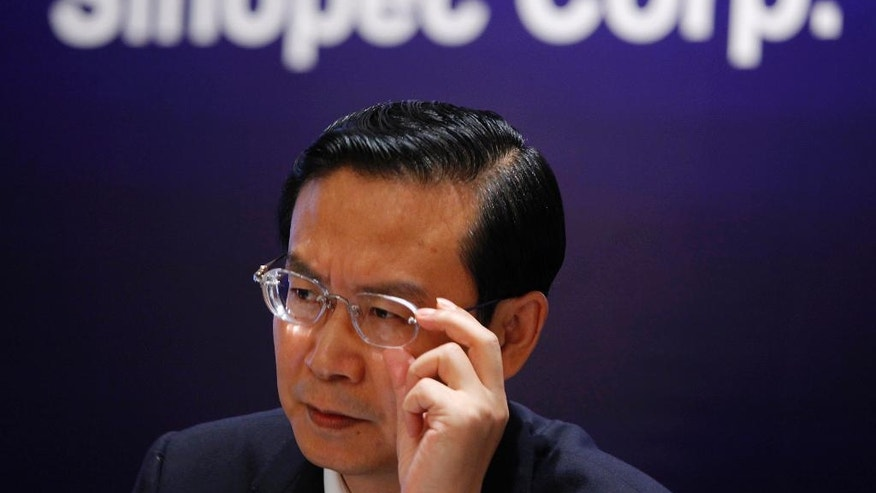FILE - In this Aug. 24, 2009 file photo, Sinopec then Chairman Su Shulin adjusts his glasses during a press conference in Hong Kong. The governor of China's economically vital eastern province of Fujian has been placed under investigation amid President Xi Jinping's ongoing attack on corruption at all levels of government. Su took over as Fujian governor in 2011 after a lengthy career in the oil industry, which has been a major target of anti-corruption investigators. (AP Photo/Vincent Yu, File)