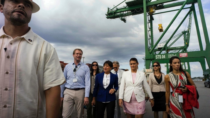 U.S. Commerce Secretary Penny Pritzker walks with the Directors of Mariel Port in Cuba,Tuesday, Oct. 6, 2015.