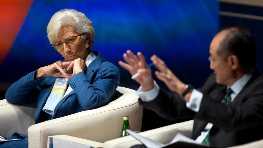 International Monetary Find (IMF) Managing Director Christine Lagarde listens as World Bank President Jim Yong Kim addresses a forum in Lima, Peru, Wednesday, Oct. 7, 2015, during the annual meetings of the World Bank Group and IMF. Latin America's economy is expected to enter recession this year for the first time since the end of the global financial crisis as China's slowdown drives lower demand for the region's commodities, threatening to undo recent progress in reducing poverty, the International Monetary Fund said Wednesday. (AP Photo/Rodrigo Abd)