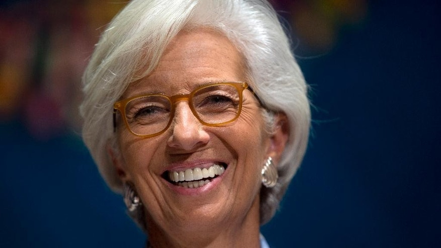 International Monetary Find (IMF) Managing Director Christine Lagarde laughs during a forum in Lima, Peru, Wednesday, Oct. 7, 2015, during the annual meetings of the World Bank Group and IMF. Latin America's economy is expected to enter recession this year for the first time since the end of the global financial crisis as China's slowdown drives lower demand for the region's commodities, threatening to undo recent progress in reducing poverty, the International Monetary Fund said Wednesday. (AP Photo/Rodrigo Abd)