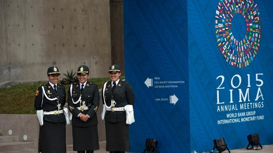 "Policewomen stand guard outside the convention center, the venue for the IMF and World Bank annual meetings, in Lima, Peru, Wednesday, Oct. 7, 2015. The International Monetary Fund says the biggest risks to the global economy are now in emerging markets, where private companies have racked up considerable debt amid a fifth straight year of slowing growth. Top bank official Jose Vinals says the Fund estimates ""that there is up to $3 trillion in over-borrowing in emerging markets."" Vinals presented the IMF's Global Financial Stability report on Wednesday at its annual meeting, being held in Peru. (AP Photo/Rodrigo Abd)"