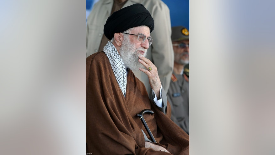 In this picture released by the official website of the office of the Iranian supreme leader on Wednesday, Sept. 30, 2015, Supreme Leader Ayatollah Ali Khamenei attends a graduation ceremony of the Iranian Navy cadets in the Northern city of Noshahr, Iran. (Office of the Iranian Supreme Leader via AP)
