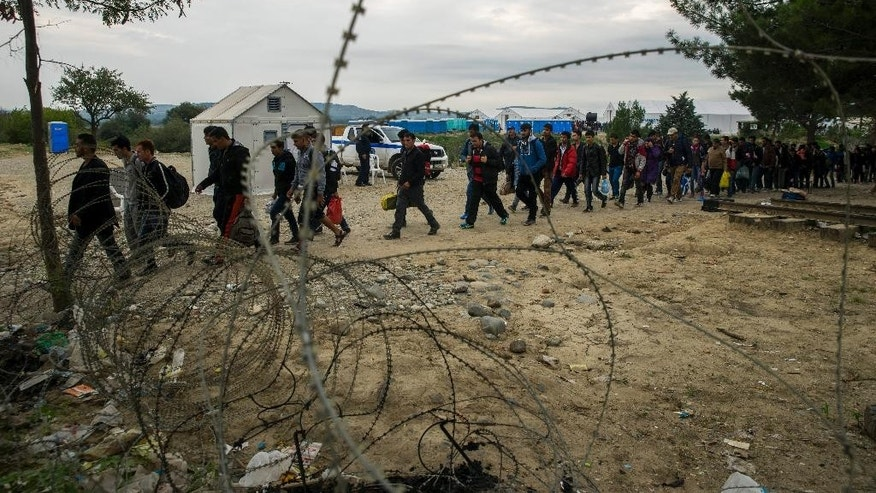 Migrants arrive at the Macedonian-Greek border town Gevgelija in Macedonia, Wednesday, Oct. 7, 2015. (Zoltan Balogh/MTI via AP)