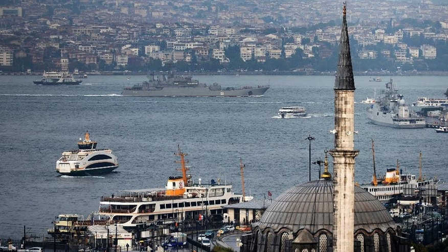 A Russian warship passes through the Bosphorus, in Istanbul, en route to the Mediterranean Sea, Tuesday, Oct. 6, 2015. Russia began launching military operations in Syria on Wednesday, targeting mainly central and northwestern Syria, strategic regions that are the gateway to its long-term ally President Bashar Assad's main strongholds.  (AP Photo)