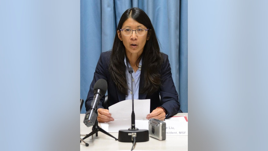 "Joanne Liu, President of Medecins Sans Frontieres, MSF, International, speaks during a news conference on the US air strike on a hospital in Kunduz, Afghanistan, in Geneva, Switzerland, Wednesday, Oct. 7, 2015. Liu, told reporters that the weekend strike ""was not just an attack on our hospital, it was an attack on the Geneva Conventions. This cannot be tolerated."" (Martial Trezzini/Keystone via AP)"