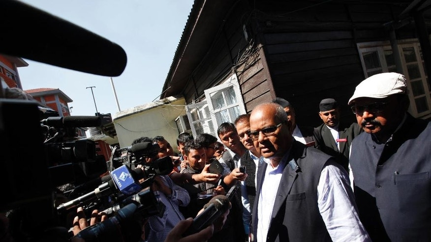 FILE - In this Tuesday, Oct. 6, 2015 file photo, Laxman Lal Karna from the United Democratic Madhesi Front talks to the media after talks with government negotiators in Kathmandu, Nepal. Negotiators from Nepal's government and the main group protesting against the new constitution discussed the main issue of expanding the size of proposed states on Wednesday, though little progress was made on the second day of talks. (AP Photo/ Niranjan Shrestha, File)