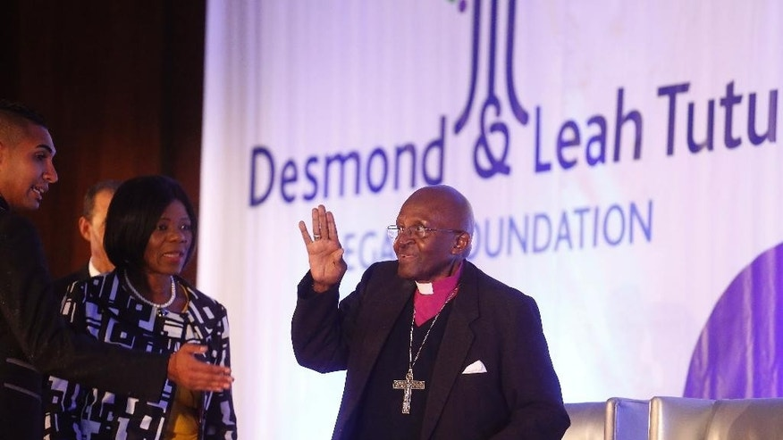 South Africa's Nobel Peace Prize winner Desmond Tutu, center, wave to people as he arrive for the fifth annual Desmond Tutu Peace Lecture at the University of the Western Cape in Cape Town, South Africa, Wednesday, Oct. 7, 2015. South Africa's Nobel Peace Prize winner Desmond Tutu marked his 84th birthday on Wednesday with one of his first public appearances since being hospitalized for a persistent infection. (AP Photo/Schalk van Zuydam)