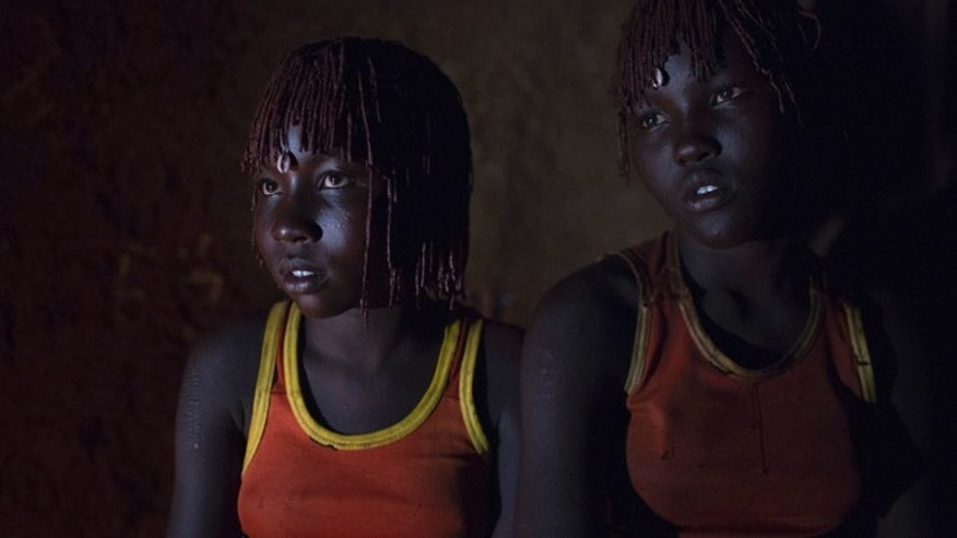 Oct. 16, 2014: Pokot girls wait together in a home before their circumcision ceremony in a village in Kenya.