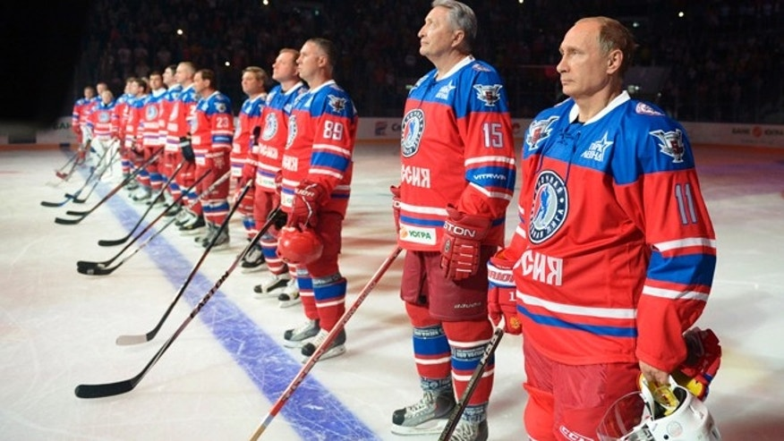 Oct. 7, 2015: Russian President Vladimir Putin, right, with Russian ice hockey star Alexander Yakushev, before an ice hockey match between former NHL stars and officials at the Shayba Arena in Sochi, Russia.