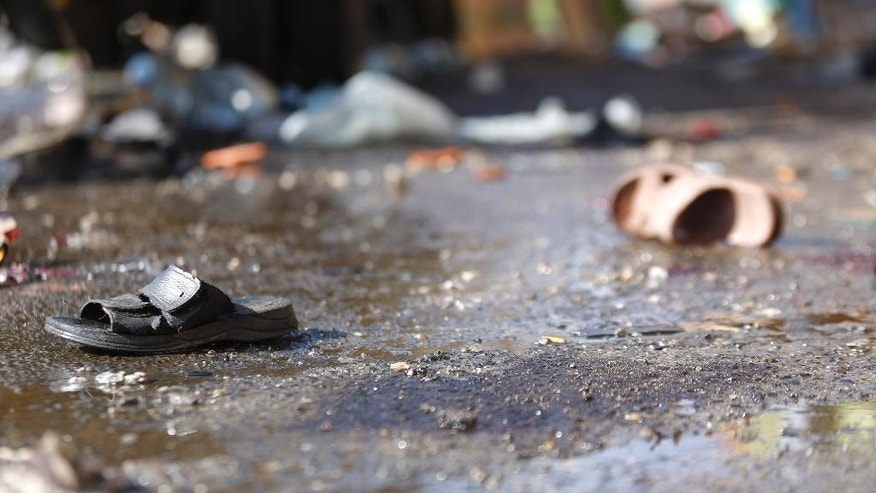 Sandals of victims lie on the ground, at the site of  a Tuesday night suicide bomb attack next to a mosque in Sanaa, Yemen, Wednesday, Oct. 7, 2015. The attack killed seven people and wounded three.  Islamic State militants claimed responsibility for the blast online.  (AP Photo/Hani Mohammed)