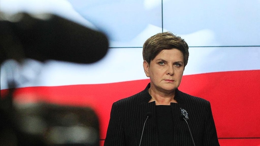 Conservative opposition Law and Justice party's candidate for prime minister in Poland's Oct. 25 general elections, Beata Szydlo, is speaking at a news conference in Warsaw, Poland, Thursday, Oct. 8, 2015. The party is expected to defeat the ruling pro-business Civic Platform party, which, it says, is acting against Poland's economic and political interests. (AP Photo/Czarek Sokolowski)