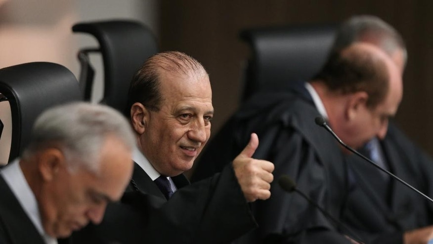 CORRECTS OFFICIAL POSITION OF NARDES - Augusto Nardes, minister of Federal Court of Accounts makes thumbs up sign during a court session in Brasilia, Brazil, Wednesday, Oct. 7, 2015. The court is due to issue a ruling on wether President Dilma Rousseff used illegal accounting measures to balance its books. Critics say these irregular accounting measures were used in order to give the appearance that the government was sticking to its budget surplus targets, ahead of Rousseff's re-election bid in October last year. (AP Photo/Eraldo Peres)