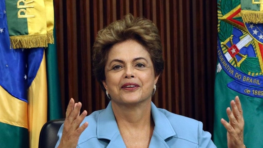 Brazil's President Dilma Rousseff attends a Cabinet meeting at the Planalto Presidential Palace, in Brasilia, Brazil, Thursday, Oct. 8, 2015. Analysts say the Brazilian president's leadership capacity has been dealt a serious blow by a federal audit court ruling that her government violated accounting practices last year and broke the country's finance law by illegally using money from state banks to fill budget holes. They say the ruling could add fuel to efforts by Rousseff's opponents to begin impeachment proceedings against her in Congress. (AP Photo/Eraldo Peres)