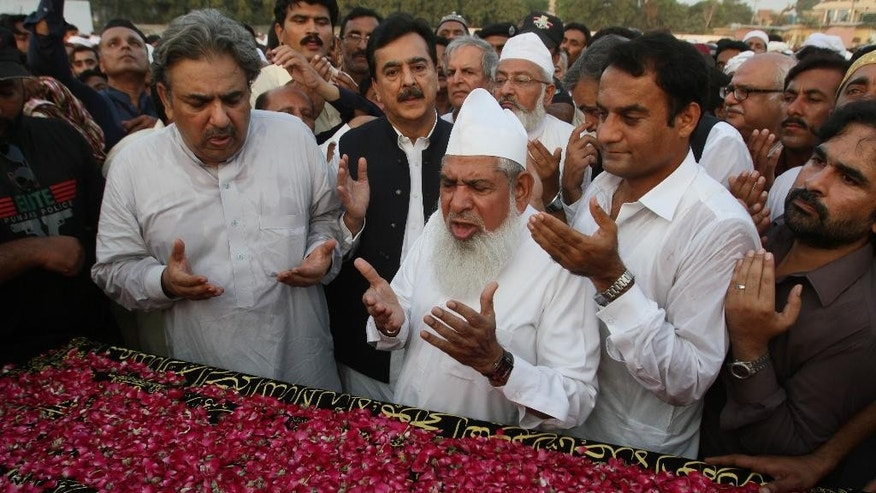 Pakistan's former Prime Minister Yousuf Raza Gilani, center in black, prays for his nephew who died last month in a stampede during the hajj pilgrimage in Saudi Arabia, during a funeral prayer in Multan, Pakistan, Monday, Oct. 5, 2015. Saudi authorities have said the disaster in Mina happened as two waves of pilgrims converged on a narrow road, causing hundreds of people to suffocate or be trampled to death. (AP Photo/Asim Tanveer)
