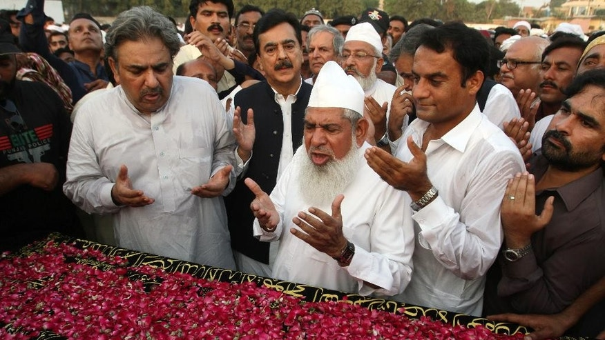 FILE - In this Monday, Oct. 5, 2015, file photo, Pakistan's former Prime Minister Yousuf Raza Gilani, center in black, prays for his nephew who died September 2015 in a stampede during the hajj pilgrimage in Saudi Arabia, during a funeral prayer in Multan, Pakistan. The crush and stampede outside the holy city of Mecca killed at least 1,399 people from around the world during the hajj pilgrimage, a new tally Thursday, Oct. 8, showed, more than 600 more than the kingdom's official toll. (AP Photo/Asim Tanveer, File)